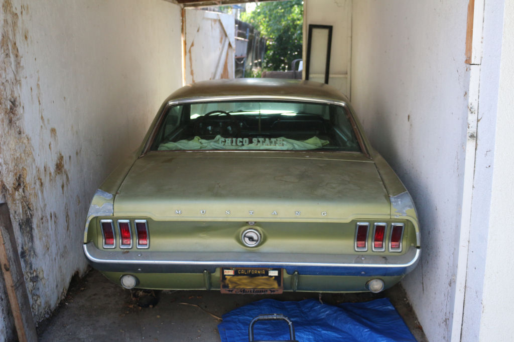 1967 Ford Mustang in storage rear end